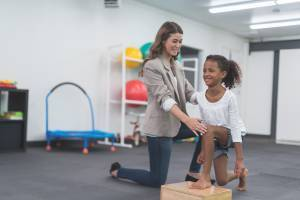 physical therapist working with child