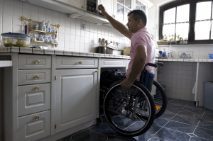 wheelchair man in kitchen